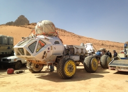 Aerial Filming The Martian in Wadi Rum, Jordan showing  Mars Rover | Marzano Films